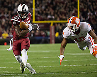 The tenth ranked South Carolina Gamecocks host the 6th ranked Clemson Tigers at Williams-Brice Stadium in Columbia, South Carolina.  USC won 31-17 for their fifth straight win over Clemson.  South Carolina Gamecocks wide receiver Bruce Ellington (23), Clemson Tigers safety Korrin Wiggins (12)