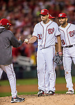 13 October 2016: Washington Nationals starting pitcher Max Scherzer hands the ball to Manager Dusty Baker on the mound during Game 5 of the NLDS against the Los Angeles Dodgers at Nationals Park in Washington, DC. The Dodgers edged out the Nationals 4-3, to take Game 5 of the Series, 3 games to 2, and move on to the National League Championship Series against the Chicago Cubs. Mandatory Credit: Ed Wolfstein Photo *** RAW (NEF) Image File Available ***