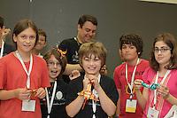 Nathan Ascher (back center) teaches a complex origami dragon design by Diego Fernando Becerra Ramirez to a clas at OrigamiUSA 2013