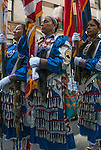Color Guard Native American Women Warriors before the start of the Veteran's Day Parade in NYC.<br /> <br /> Native American Women Warriors are the first ever recognized all Native American Women Color Guard. Organized March 2010 with their first performance at the Denver March Pow Wow 2010.<br /> <br /> At that powwow, three female Soldiers, who represented the nations of the Crow, Northern Cheyenne and Navajo, were recognized as a color guard of uniqueness. Mitchelene BigMan designed a jingle dress in favor of her papatriotism to the military with the colors red, white, blue and Cheyenne pink. Unit, combat, U.S. Flag, Iraqi Freedom patches along with the Soldier&rsquo;s rank were sewn onto the dresses. Mitchelene chose the jingle dress and style of dance because of its meaning: prayer and healing.