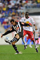 Luciano Castan (6) of Santos FC plays the ball away from Ibrahim Salou (29) of the New York Red Bulls during the first half of a friendly between Santos FC and the New York Red Bulls at Red Bull Arena in Harrison, NJ, on March 20, 2010. The Red Bulls defeated Santos FC 3-1.