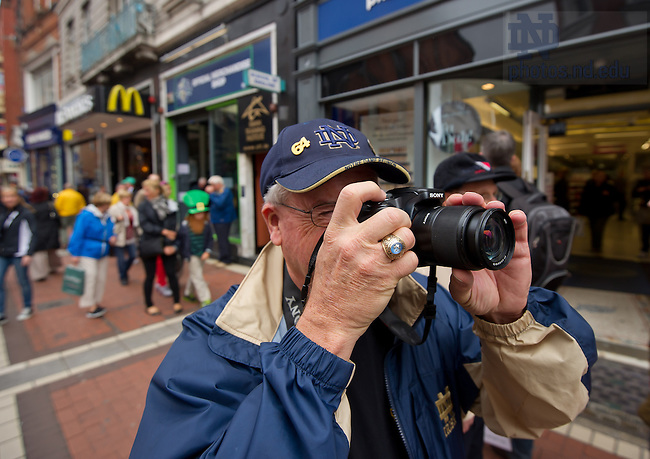 Aug. 31, 2012; A Notre Dame fan takes photos on Grafton Street in Dublin...Photo by Matt Cashore/University of Notre Dame