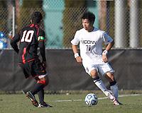 University of Connecticut defender Flo Liu (16) looks to pass. .NCAA Tournament. University of Connecticut (white) defeated Northeastern University (black), 1-0, at Morrone Stadium at University of Connecticut on November 18, 2012.