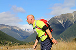 NELSON LAKES, NEW ZEALAND - APRIL 18:  Michael Passant crosses the Travers River during the 2015 Alpine Lodge Loop The Lake trail run at Lake Rotoiti on April 18 16, 2015 in Nelson, New Zealand. (Photo by Marc Palmano/Shuttersport Limited)