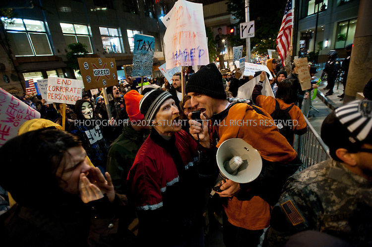 11/2/2011--Seattle, WASH., USA..Several hundred demonstrators from Occupy Seattle headed downtown and marched to the Sheraton Hotel where JPMorgan Chase CEO Jamie Dimon was invited to speak Wednesday night. Dimon was a speaker at a University of Washington Foster School of Business leadership celebration...Here protesters rally outside the Sheraton Hotel...©2011 Stuart Isett. All rights reserved