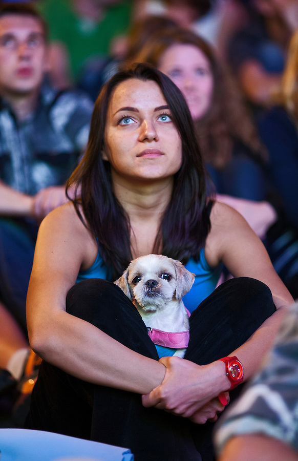 Moscow, Russia, 01/07/2012..An Italian supporter with her dog in the Euro 2012 Fan Zone in Gorky Park, as Spain beat Italy 4-0 in the final of the soccer championship.