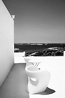 modern white chairs<br /> <br /> <br /> The wife of renowned Swiss architect, Aurelio Galfetti, owns this house on the island of Paros in Greece.  The building reflects the genius of the designer and the couple&rsquo;s love for freedom of movement and the Greek light.