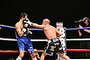 Jamie Moore (Manchester, Black shorts) defeats Michele Piccirillo (Italy, Blue shorts) .in a Light middleweight boxing contest for the European EBU Title at Robin Park Centre, Wigan promoted by Frank Maloney - 06/03/09 - .MANDATORY CREDIT: Chris Royle/TGSPHOTO - Self billing applies where appropriate - Tel: 0845 094 6026