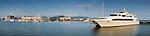 Superyacht in Marlin Marina with city skyline in background.  Cairns, Queensland, Australia