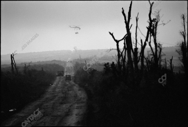 A Sikorsky Skycrane helicopter carries cargo near the base at Khe Sanh used to launch the Lam Son 719 raid into Laos in an attempt to shut down North Vietnamese troop movements along the Ho Chi Minh trail. Khe Sanh, South Vietnam, March 1971