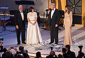 Vice President -elect of The United States Mike Pence, his wife Karen Pence and FIRST LADY-elect of The United States listen to President-elect of The United States Donald J. Trump speak while attending a &quot;Candlelight&quot; dinner to thank donors in Washington, DC, January 19, 2017. <br /> Credit: Chris Kleponis / Pool via CNP