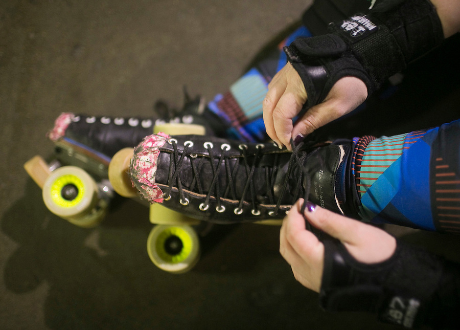 A skater laces up at the Storm City Roller Girls practice in Vancouver Thursday February 9, 2017. (Photo by Natalie Behring for the Columbian)
