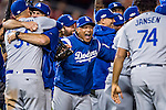 14 October 2016: Los Angeles Dodgers Manager Dave Roberts erupts with joy after winning the deciding NLDS Game 5 against the Washington Nationals at Nationals Park in Washington, DC. The Dodgers edged out the Nationals 4-3, to take Game 5, and the Series, 3 games to 2, moving on to the National League Championship against the Chicago Cubs. Mandatory Credit: Ed Wolfstein Photo *** RAW (NEF) Image File Available ***