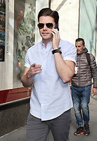 NEW YORK, NY - APRIL 13: Josh Henderson seen while on his phone wearing his Ray-Ban sunglasses on a sunny Thursday morning in New York City on April 13,  2017. Credit: RW/MediaPunch