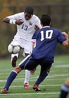 HYATTSVILLE, MD - OCTOBER 26, 2012:  Arion Sobers-Assue (13) of DeMatha Catholic High School lobs the ball over Arjan Ganji (10) of St. Albans during a match at Heurich Field in Hyattsville, MD. on October 26. DeMatha won 2-0.