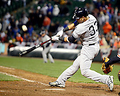 New York Yankees right fielder Nick Swisher (33) hits a two run home run in the tenth inning against the Baltimore Orioles at Oriole Park at Camden Yards in Baltimore, MD on Thursday, April 11, 2012.  The Yankees won the game 6 - 4..Credit: Ron Sachs / CNP.(RESTRICTION: NO New York or New Jersey Newspapers or newspapers within a 75 mile radius of New York City)