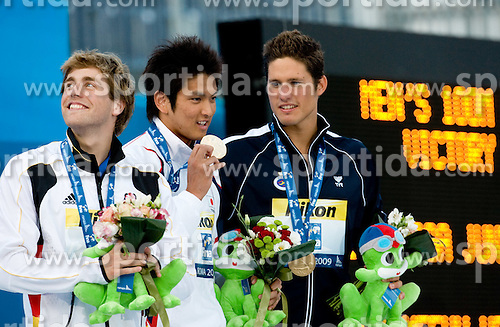 Second placed Helge Meeuw of Germany, winner Junya Koga of Japan and third placed Aschwin Faber Wildeboer of Spain at victory ceremony after the Men's 100m  Backstroke Final during the 13th FINA World Championships Roma 2009, on July 28, 2009, at the Stadio del Nuoto,  in Foro Italico, Rome, Italy. (Photo by Vid Ponikvar / Sportida)