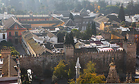High angle view of Real Alcazar, Seville, Spain, pictured on December 27, 2006, in the morning. The Real Alacazar was commissioned by Pedro I of Castile in 1364 to be built in the Mudejar style by Moorish craftsmen. The palace, built on the site of an earlier Moorish palace, is a stunning example of the style and a UNESCO World Heritage site. The gardens are a mixture of French, Moorish and Renaissance styles. Picture by Manuel Cohen.