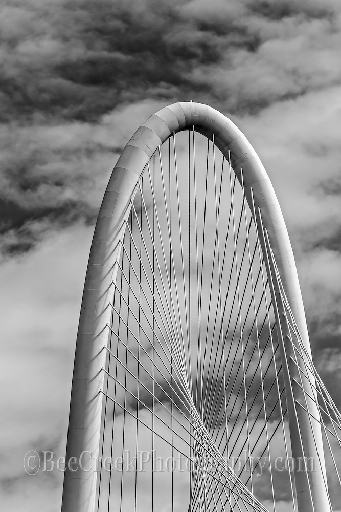 This is the top of the arch on the Margaret Hunt Hill Bridge in Dallas Texas with clouds in black and white.  I really like the contrast ot the sky and webbing of the bridge arch. This bridge is 40 stories high so it can be seen form quite a distance and is part of the Dallas skyline.