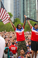 CHICAGO, Illinois - Monday June 16, 2014: Lupe Fiasco celebrates the 2-1 victory of the US Men's National team over Ghana at Grant Park.