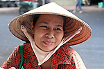 A newspaper seller poses for a portrait one early morning in Pham Ngu Lao ward, Ho Chi Minh City, Vietnam. Aug. 27, 2011.