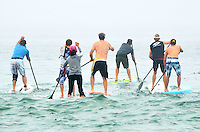 Competitors paddle out during Santa Monica Baykeeper and the Waterkeeper Alliances  1st Annual Splash: Stand-Up for Clean Water paddleboard race & festival at Santa Monica beach on Saturday, April 21, 2012.