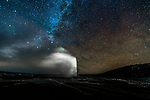 Old faithful geyser under the Milky Way, Yellowstone National Park, Wyoming, USA