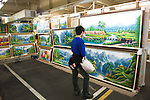 A man looks at landscape painting at the Taipei Artist Market in Taipei, Taiwan.