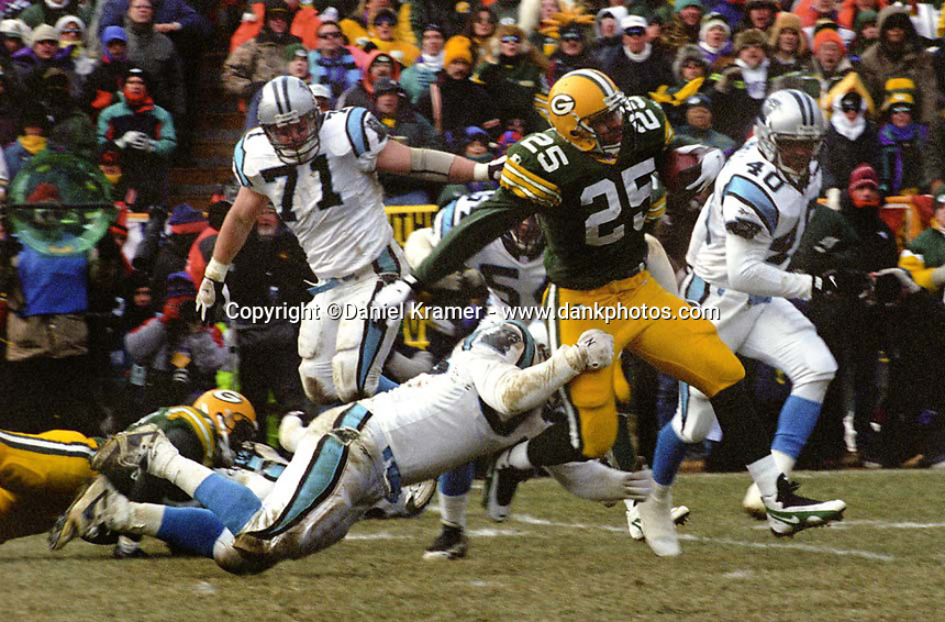 """Green Bay Packers running back Dorsey Levens rushed for 88 yards and added another 117 yards receiving as the Packers defeated the Panthers 30-13 in the NFC Championship to advance to their first Super Bowl in 29 years. This was the first title game in Green Bay since the """"Ice Bowl"""" in 1967."""