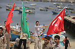 Palestinians hold Turkish flags during a rally marking the third anniversary of attack on the Turkish flotilla Mavi Marmara at Gaza seaport on May 31, 2013. Turkey broke off diplomatic relations with Israel in 2010, after the IDF (Israeli Defence forces) raided the ship Mavi Marmara as it attempted to break Israel s naval blockade of Gaza, killing nine Turkish activists on board. Photo by Ashraf Amra