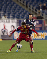 Real Salt Lake forward Paulo Araujo Jr. (23) attempts to control the ball as New England Revolution defender Ryan Cochrane (45) pressures. In a Major League Soccer (MLS) match, Real Salt Lake defeated the New England Revolution, 2-0, at Gillette Stadium on April 9, 2011.
