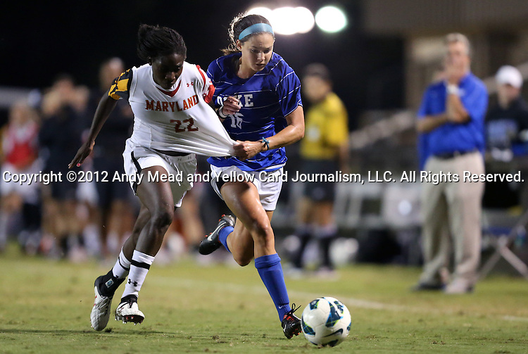 20 September 2012: Duke's Laura Weinberg (16) pulls the jersey of Maryland's Shade Pratt (22). The University of Maryland Terrapins played the Duke University Blue Devils to a 2-2 tie after overtime at Koskinen Stadium in Durham, North Carolina in a 2012 NCAA Division I Women's Soccer game.