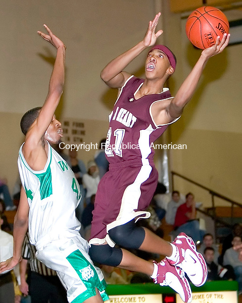 WATERBURY, CT- 15 DEC 06- 121506JT09- <br /> Sacred Heart's Effren Ellison draws a foul from Wilby's Cyrell Nealy as he goes to the basket during Friday's game at Wilby.<br /> Josalee Thrift Republican-American