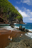 Secluded Kaihalulu Beach also known as Red Sands Beach. Located near the town of Hana and the Hana Hotel on Maui's southeast coast.