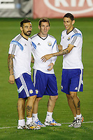 Lionel Messi of Argentina warming up during the training session with Ezequiel Lavezzi and Angel Di Maria