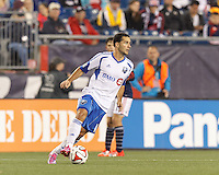 Foxborough, Massachusetts - September 13, 2014: In a Major League Soccer (MLS) match, the New England Revolution (dark blue/white) defeated Montreal Impact (white/light blue), 2-1, at Gillette Stadium.