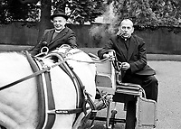 Roman Catholic Cardinal Tomas O Fiach smoking his pipe alongside Church of Ireland Primate John Armstrong in an Irish jaunting car at a Tourist Board function to publicise the City of Armagh, N Ireland, UK. The two church leaders were close friends. Armagh is the Irish ecclesiatical captial for both denominations. 198005001. Copyright Image from Brendan Murphy, c/o Irish News, 113 Donegall Street, Belfast, UK, BT1 2GE...Tel: +44 28 9032 2226.Email: photographers@irishnews.com..IMPORTANT: If you wish to use this image or any other of my images please go to www.victorpatterson.com and click on Terms & Conditions. My terms are exactly the same as those for Victor Patterson. Then contact me by email or phone with the reference number(s) of the image(s) concerned.