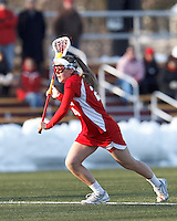 Boston University midfielder Sofia Robins (24) takes a shot from the free position..Boston College (white) defeated Boston University (red), 12-9, on the Newton Campus Lacrosse Field at Boston College, on March 20, 2013.