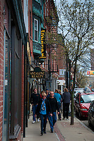 People walk down the street in Little Italy district (North End) of Boston, MA