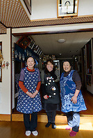 Staff at the Ashiya guesthouse. Owner Yuki Sato is on the left. Tsuruoka, Yamagata Prefecture, Japan, April 9, 2016. The city of Tsuruoka in Yamagata Prefecture is famous for its sansai mountain vegetable cuisine. These foraged grasses, fungi and vegetables are also used by the mountain ascetics of the Shugendo religion.