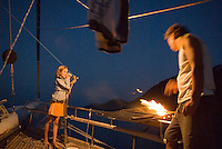 Fethiye to Kas, Turkey, October 2007. While the BBQ is lit to grill the fish, other people prepare the drinks. The Blue Cruise on a wooden sailing yacht, better known as gulet, is one of the best ways to explore the Turkish Mediterranean Coast. Photo by Frits Meyst / MeystPhoto.com
