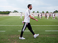 D.C. United head coach Ben Olsen walks to the bench before the quarterfinals of the US Open Cup at the Maryland SoccerPlex in Boyds, Md.  D.C. United defeated the New England Revolution, 3-1.