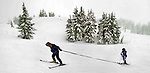 February 07, 2004 - (LtoR) Larry Sheeley and his son Lance, 7, of West Linn make their way along the slopes. The Shriner Hospital's Ski and Snowboard program pairs volunteers with disabled kids at  Timberline on Mt. Hood....KEYWORDS: skiers, children