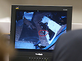 A photo of the Bushmaster rifle is shown on the back seat of the Cheverolet Caprice used by sniper suspect John Allen Muhammad is displayed on a screen in courtroom 10 at the Virginia Beach Circuit Court in Virginia Beach, Virginia on November 3, 2003.<br /> Credit: Lawrence Jackson - Pool via CNP