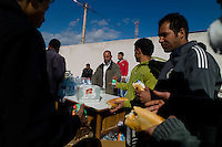 Ras Ajdir, Feb. 23, 2011.Thousands of refugees, mostly Tunisians but also Egyptians and Libyans flee the ongoing revolution inside Libya. Refugees are being met by Tunisian citizen comitees and given food and drinks.