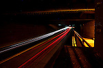 """Cars drive under """"The Underpass"""" in Swarthmore, Pennsylvania at night as seen on Monday August 8th 2011. (Photo By Brian Garfinkel)"""