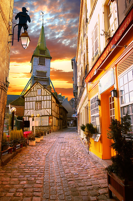 street at sunset with church and half timbered building. Honfleur, Normandy, France.