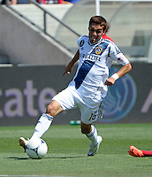 LA Galaxy midfielder Hector Jimenez (16) dribbles toward the goal.  The LA Galaxy defeated the Chicago Fire 2-0 at Toyota Park in Bridgeview, IL on July 8, 2012.