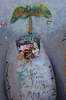 Section of the Berlin Wall depicting a detail of a painting of a seedling growing from rubbish, part of the East Side Gallery, a 1.3km long section of the Wall on Muhlenstrasse painted in 1990 on its Eastern side by 105 artists from around the world, Berlin, Germany. Picture by Manuel Cohen