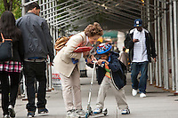 Marilyn Berger (3L), widow of Don Hewitt, talks to Danny Hodes (2R), the 8 year-old Ethiopian she has taken in, on the way back from school in New York, NY, USA, 9 April 2010. Ms Berger met him in Addis Ababa while reporting there and helped him get surgery.